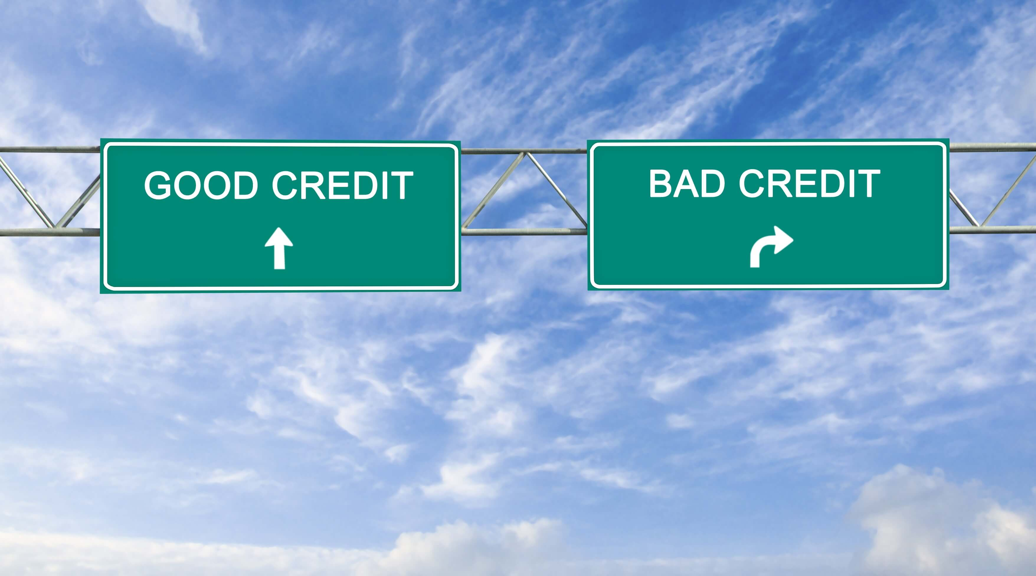Picture of two highway signs showing the words good credit and bad credit