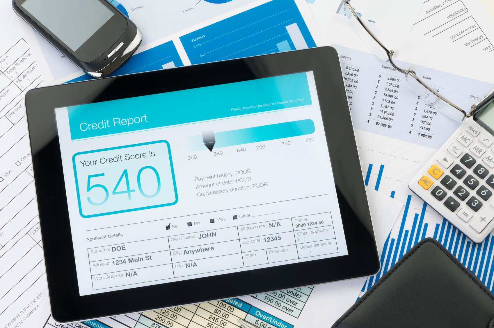 A computer tablet screen showing a poor credit score